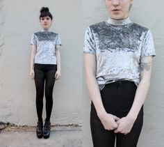 silver velvet T-shirt with stand-up collar and black skinny jeans