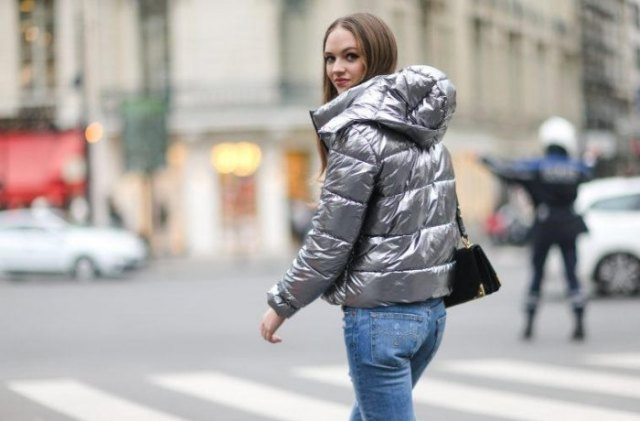 silver padded metallic jacket with light blue skinny jeans