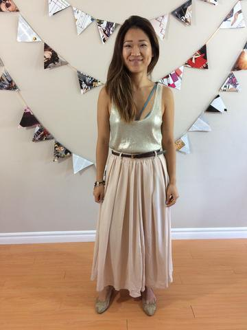 silver tank top with scoop neckline and light pink maxi pleated skirt