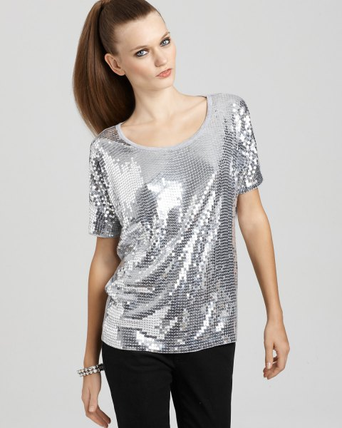 silver top with scoop neckline and black slim fit trousers