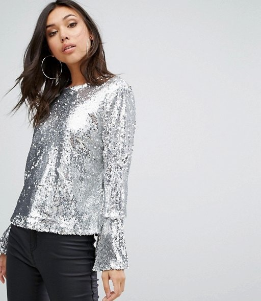 silver sequin top with long bell sleeves and black coated skinny jeans