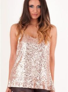 silver sequin tank top with black leather mini skirt