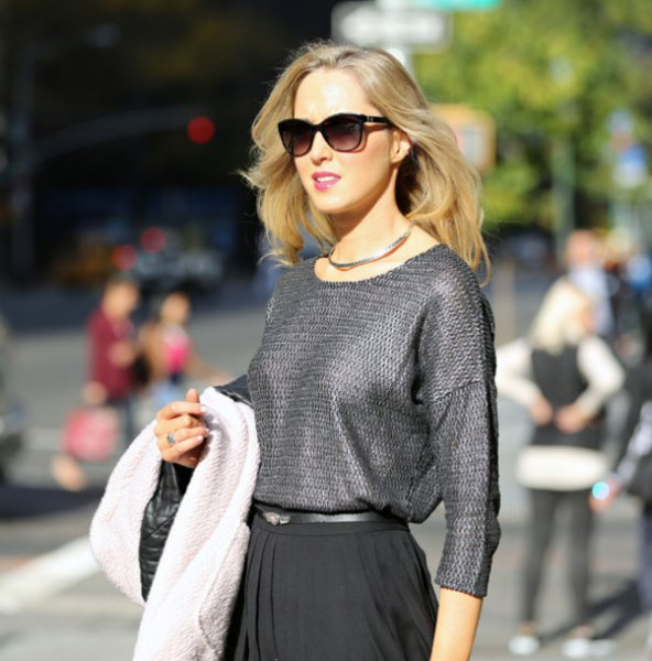 silver structured blouse with black pleated skirt
