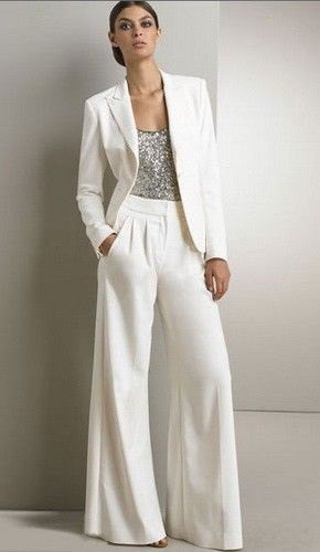 silver top with white blazer and matching flared trousers