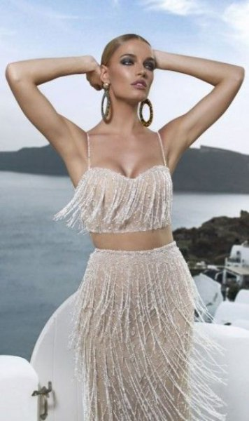 silver two-piece dress with pearl fringes