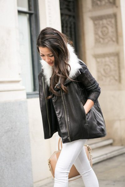 Skinny jeans and black leather jacket with a white faux fur collar