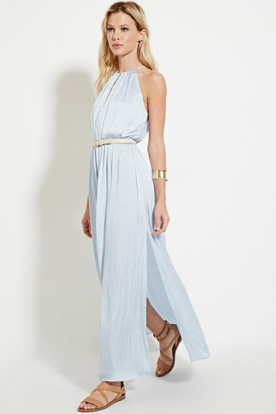 Sky blue maxi dress with halter neck and belt with bare sandals