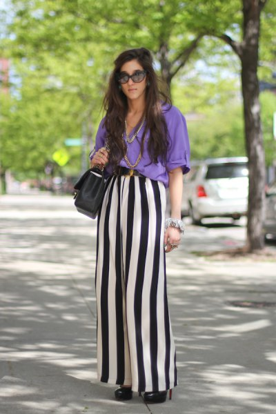 sky blue blouse with black and white striped trousers with wide legs