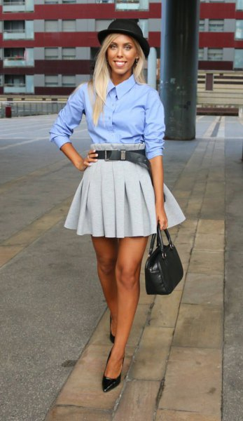 Sky blue shirt with buttons and a gray pleated mini skirt