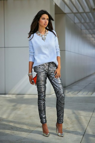 sky blue knitted sweater with black and silver tribal jeans
