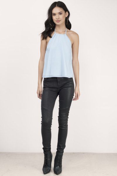 Sky blue halterneck tank top with black leather pants