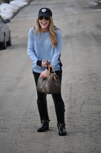 sky blue knit sweater with black elbow patches