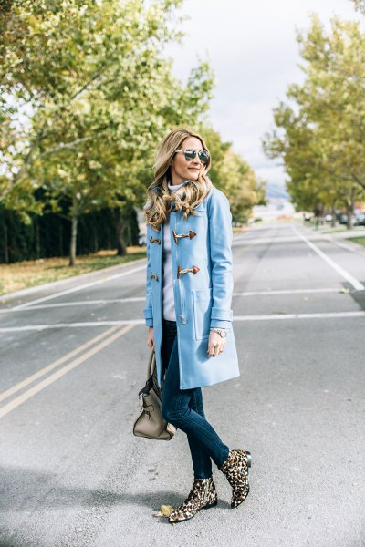 sky blue skinny jeans with a long trench coat