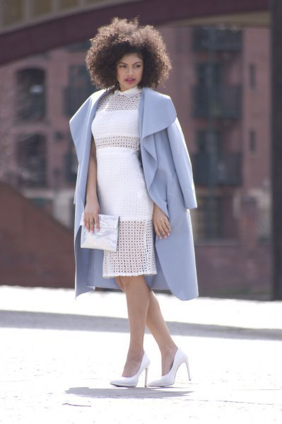 sky blue longline coat with white cocktail dress and silver clutch wallet