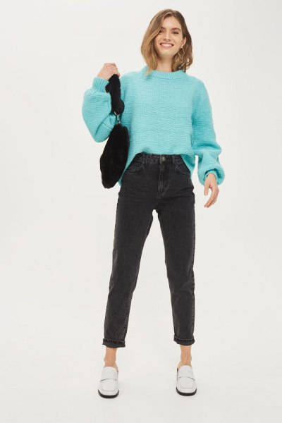 sky blue knitted sweater with mock-neck knit and black mom jeans
