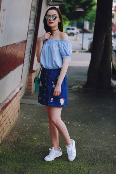 Sky blue off-the-shoulder blouse with an embroidered denim skirt with button placket