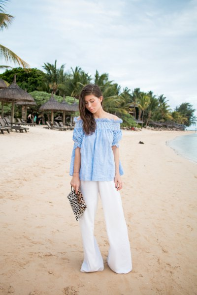 sky blue off-the-shoulder blouse with white palazzo pants