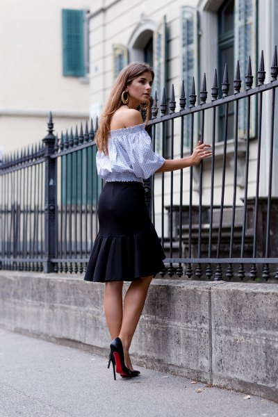 sky blue blouse with half sleeves and black knee-length skirt