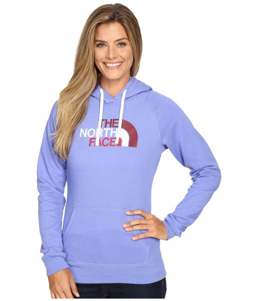 Sky blue sweater North Face hoodie with dark skinny jeans