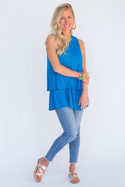 sky blue tunic top with ruffles and skinny jeans