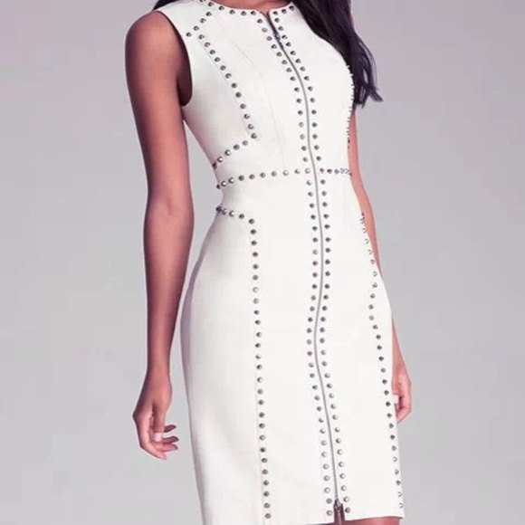 sleeveless, figure-hugging, white leather dress with rivets