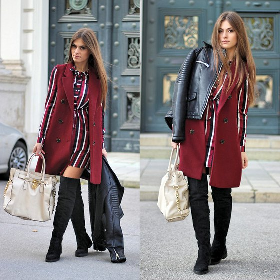 sleeveless burgundy-colored coat over a red-white-black striped long-sleeved dress