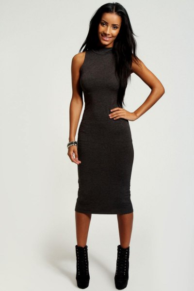 sleeveless, figure-hugging midi dress with black leather ankle boots