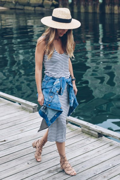 Navy straw hat and white striped leather midi dress