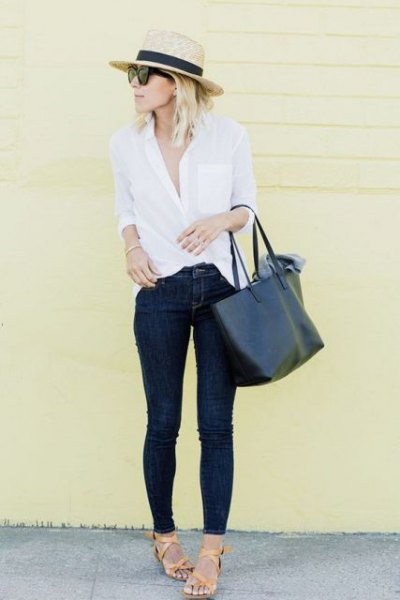 Skinny jeans with a straw hat and a white button