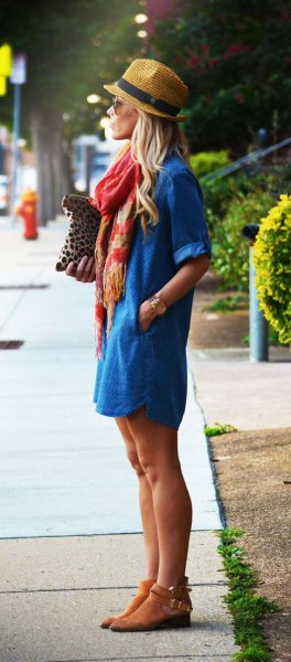 Straw hat with a blue denim dress and short suede boots