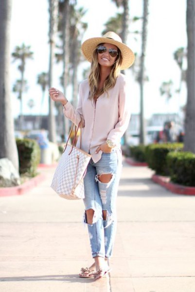 Straw hat with a pink oversized shirt and boyfriend jeans