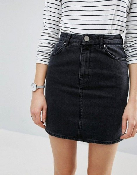 striped long-sleeved T-shirt with a black, high-waisted denim mini skirt