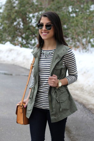 striped long-sleeved T-shirt with a silver statement chain and utility vest