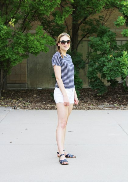 striped t-shirt with white mini cotton shorts and black slide sandals