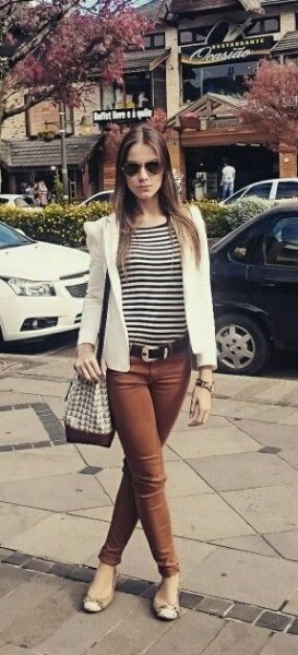 striped t-shirt with white blazer and brown jeans