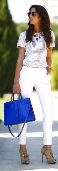 striped t-shirt with white chinos and royal blue leather handbag
