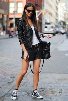 Studded moto jacket with mini leather shorts and canvas sneakers