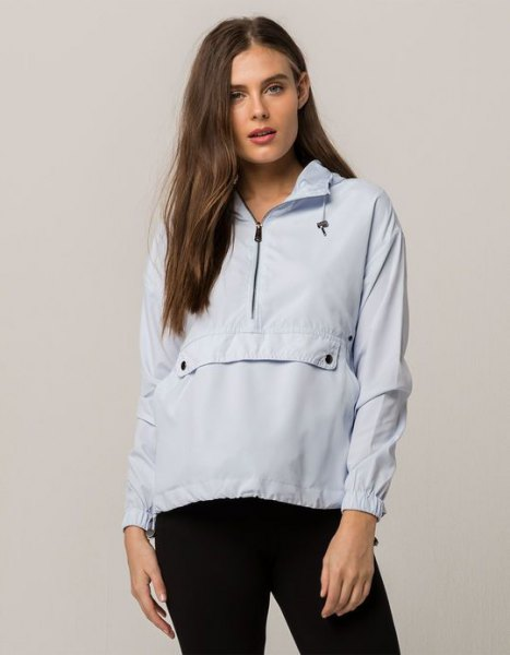 Super light blue pullover windbreaker with black skinny jeans