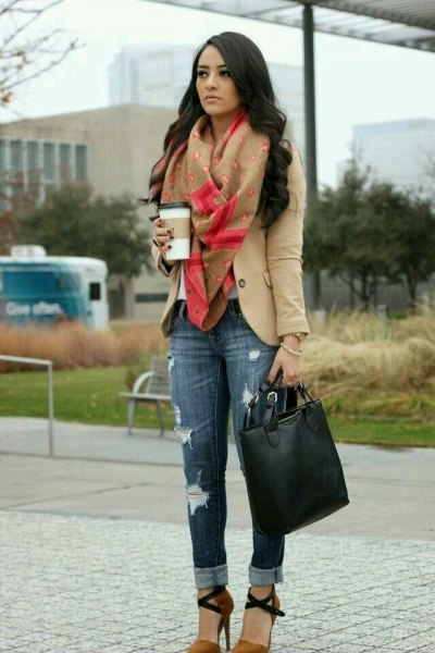 Light brown blazer with a green scarf and slim fit jeans with cuffs