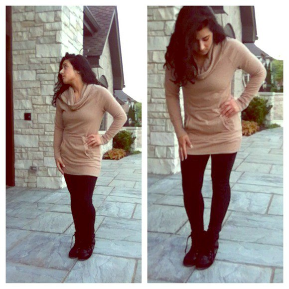Light brown tunic sweater with cowl neckline and black leggings