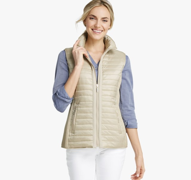light brown quilted vest over jeans