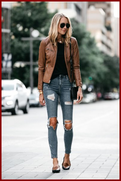 Tank jacket with a black top and heavily torn skinny jeans