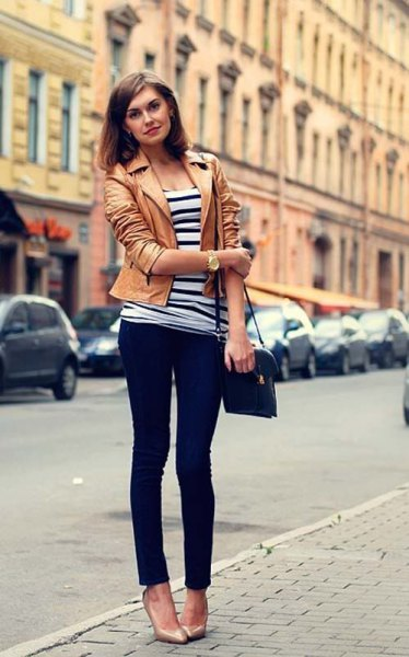 Tank leather jacket with black and white striped T-shirt and dark skinny jeans