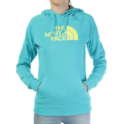 blue-green and light yellow printed sweater with light blue slim fit jeans