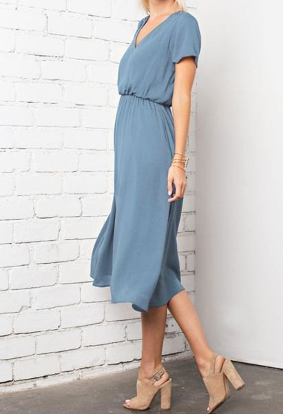 blue-green midi dress with a gathered waist and open toe heels made of pink suede