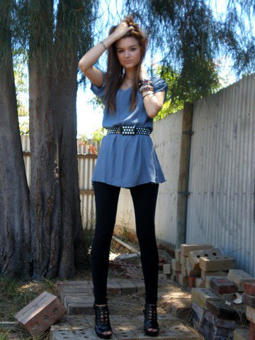 blue-green peplum top with black studded belt and leggings