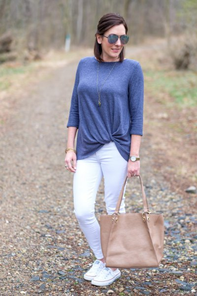 blue-green twist front top with white skinny jeans
