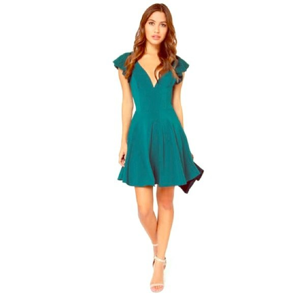 blue-green skater dress with deep V-neckline and cap sleeves