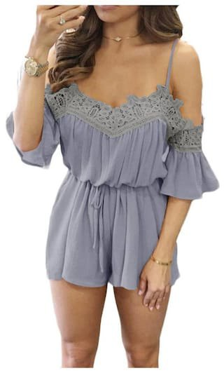 blue-green blouse with cold shoulder and pleated chiffon mini shorts