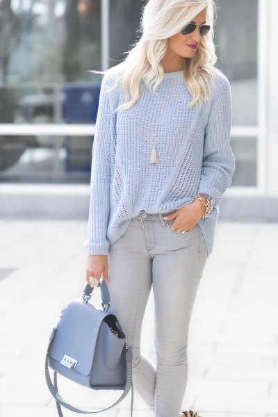blue-green crew neck sweater. Light blue skinny jeans